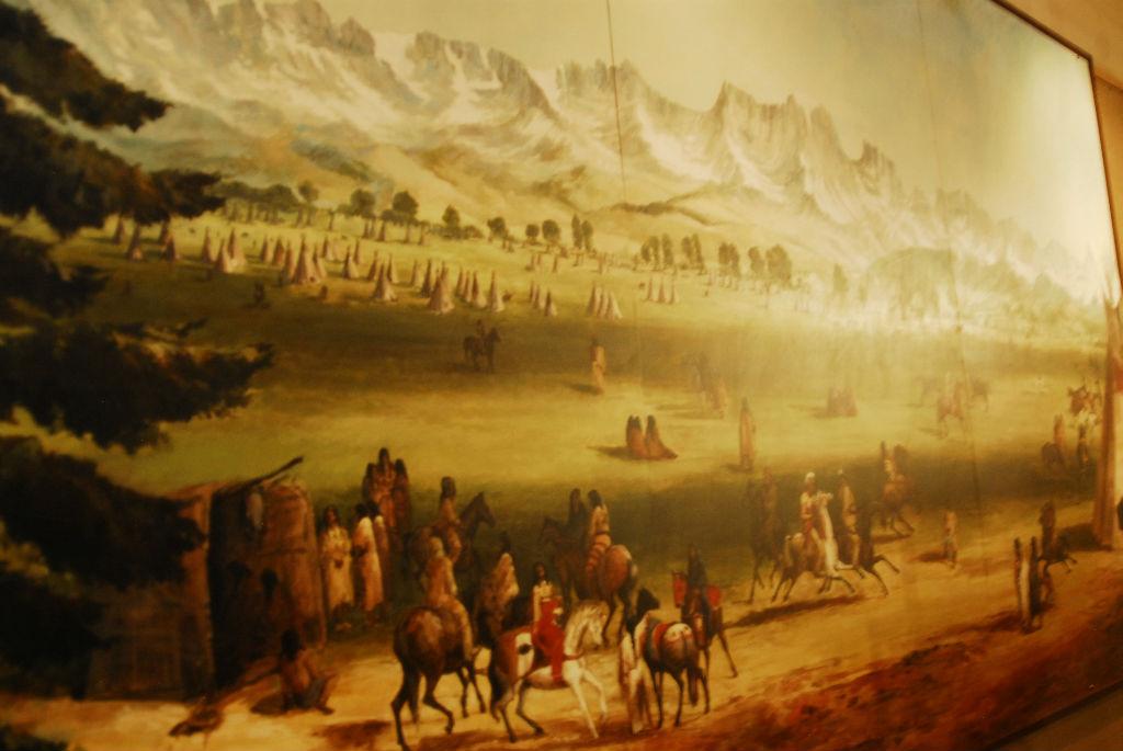 A painting of the valley filled with thousands of people.